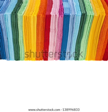 Border of tower serving colored paper napkins isolated on white background - stock photo