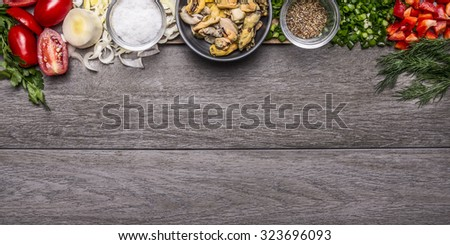 Border with tomato and leek salt mussels seasoned with herbs and chopped red pepper on wooden background top view Banner for website - stock photo