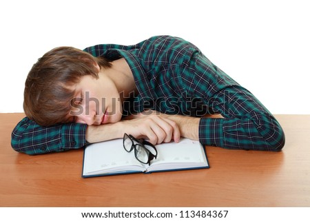 bored and tired student sleeping after hard work for exam - stock photo