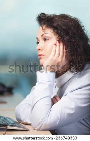 Bored and unhappy woman at work - stock photo