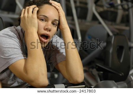 Bored at the gym. - stock photo