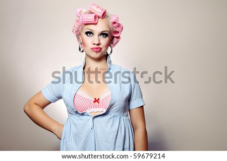 Bored attractive girl with curlers, similar available in my portfolio - stock photo