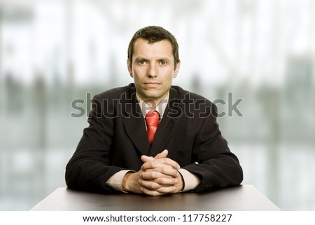 bored business man on a desk at the office - stock photo