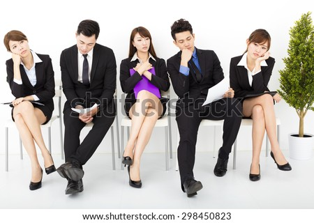 bored business people waiting for interview - stock photo