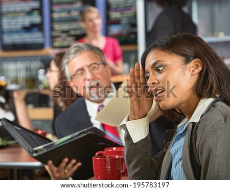Bored business woman with executive reading during lunch - stock photo