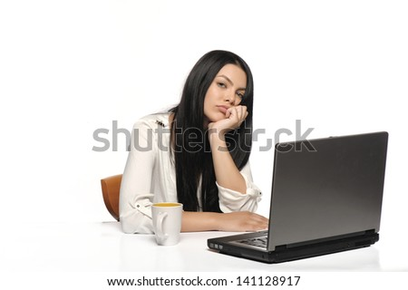 Bored business woman working on laptop looking very boring at the computer, Isolated white background - stock photo