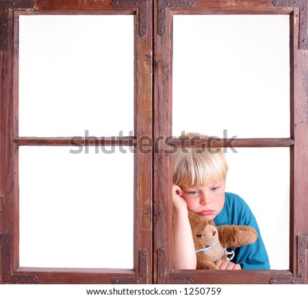 Bored child in a window - stock photo