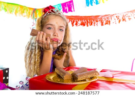 Bored gesture blond kid girl in party with chocolates and puppy chihuahua dog - stock photo