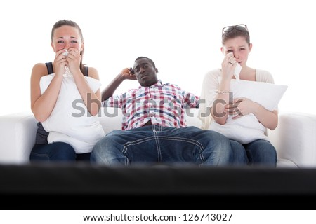 Bored Man And Two Emotional Women Watching Television On Couch - stock photo