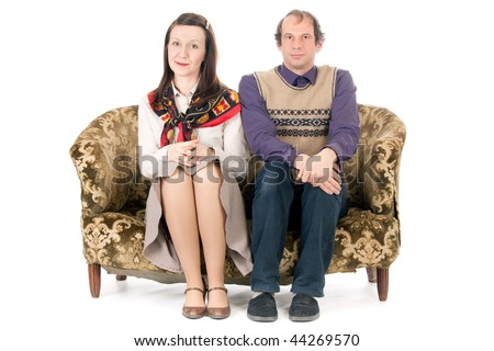 bored  old looking couple sitting on vintage couch isolated on white - stock photo