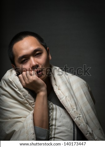 bored sleepy tired person waiting trying to stay awake - stock photo
