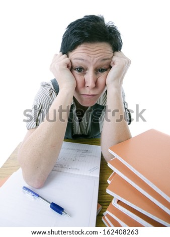bored teacher marking students work - stock photo