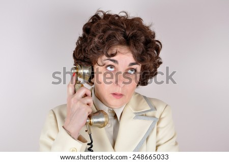 Bored  woman  looking up making a phone call on the retro telephone. - stock photo