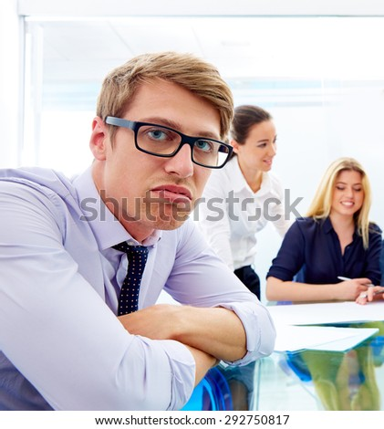 Bored young executive gesture in multi ethnic teamwork meeting at office - stock photo
