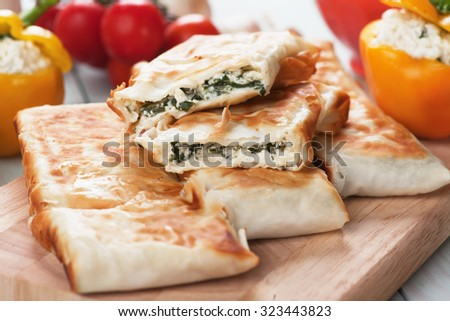 Borek or pita, filo pastry with cheese and spinach filling - stock photo