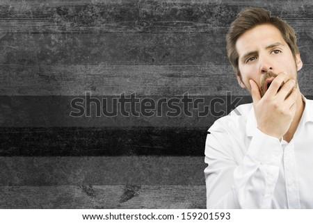 boring man on wood background - stock photo