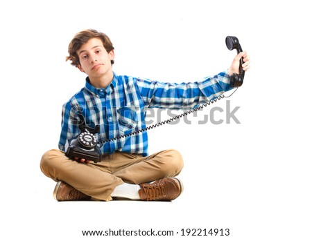 boring teenager sitting with a phone - stock photo