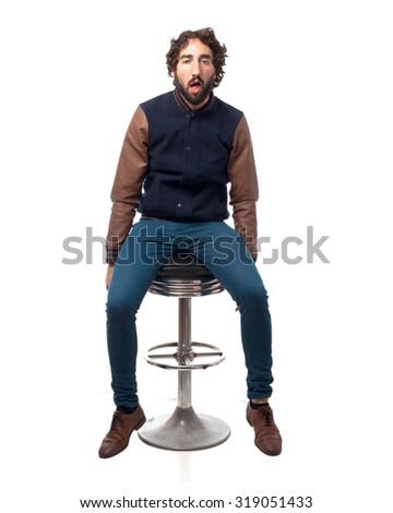 boring young man with bar stool - stock photo
