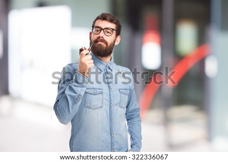 boring young man with pipe - stock photo