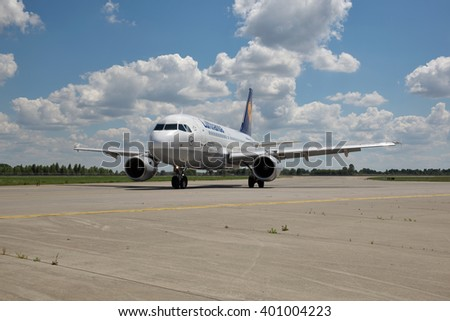 Borispol, Ukraine - July 5, 2014: Lufthansa Airbus A320 passenger plane taxiing to the terminal after landing at the airport on a sunny day - stock photo