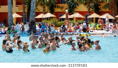 BORJ CEDRIA, TUNISIA - AUGUST 8: Tourists on holiday in an expensive hotel Carribean World are doing water aerobics in pool August 8, 2014 Borj Cedria, Tunisia.  - stock photo