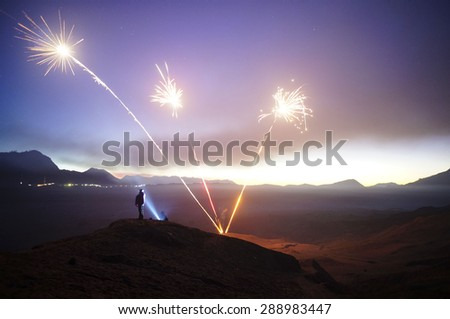 BORMO - JUNE 13, 2015: Unidentified hikers celebrating victory after reached summit of mountain at Bromo Indonesia - stock photo