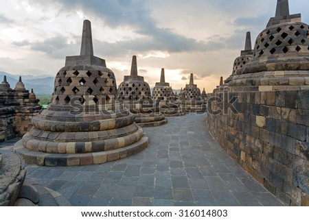 Borobudur Buddhist temple with Stone Carving, Magelang,  Java, Indonesia - stock photo