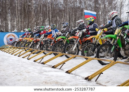 "BORODINO, RUSSIA - FEBRUARY 1: Unidentified riders at the start of the All-Russian motocross named VP Chkalov on February 1, 2015 in Borodino, motor track motorcycle club ""Gallaks�», Russia - stock photo"