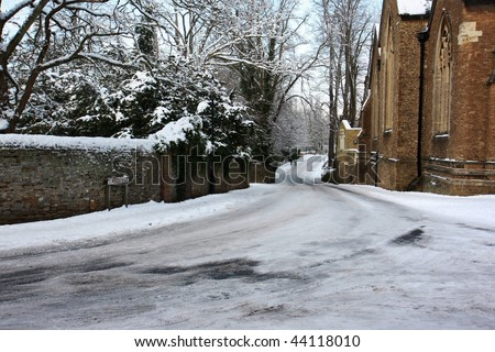 Borough street in Godalming, Surrey, England in the snow. - stock photo