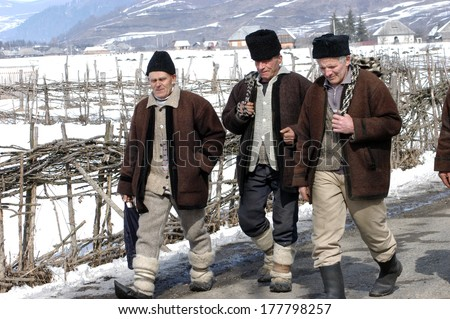 BORSA, ROMANIA - JANUARY 7: Unidentified villagers in a traditional clothes participating at a traditional Romanian wedding in Borsa village. On January 7, 2004 in Borsa, Maramures, Romania  - stock photo