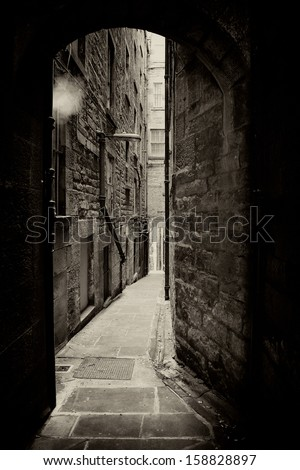 Borthwick's Close, a typical alleyway in Edinburgh, Scotland. Sepia toned vintage effect. - stock photo