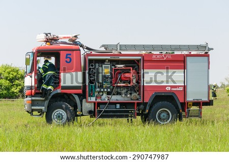 BORYSPIL, UKRAINE - MAY, 20, 2015: Red firetruck Mercedes Benz ride on call fire suppression and mine victim assistance at Boryspil International Airport, Kiev, Ukraine - stock photo