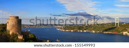 Bosphorus Panorama. Rumelihisari with the Fatih Sultan Mehmet Bridge in the background in Istanbul, Turkey.  - stock photo