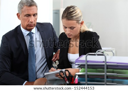 Boss and secretary working together - stock photo