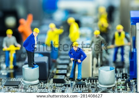 Boss and Team of engineers repairing circuit mother board. Computer repair concept - stock photo