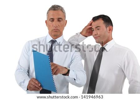 Boss explaining mistake to employee - stock photo