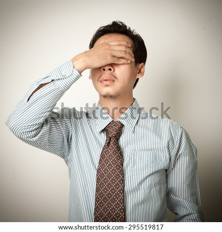 boss or businessman with stress or migraine hurt at head - stock photo