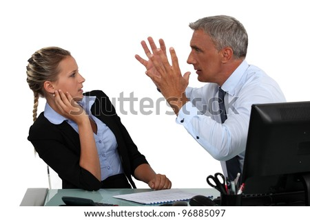 Boss shouting at assistant - stock photo