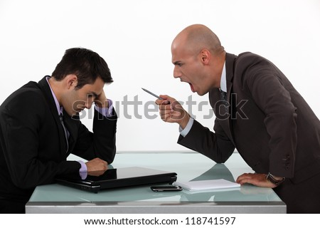 Boss shouting at employee - stock photo