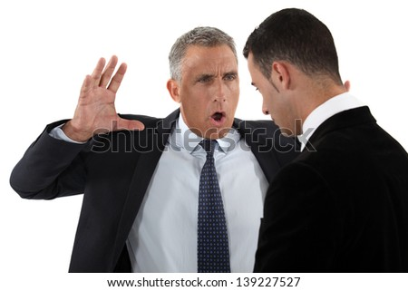 Boss shouting at employee - stock photo