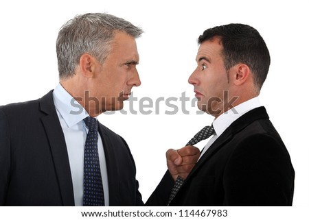 Boss threatening employee - stock photo