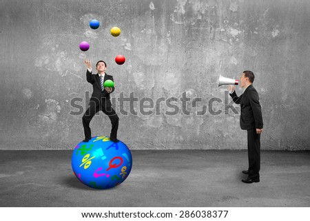 Boss using speaker yelling at businessman balancing on sphere juggling with balls, on concrete wall and floor background. - stock photo