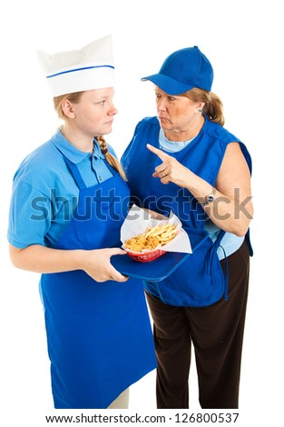 Boss yells at teenage fast food worker.  Isolated on white background. - stock photo