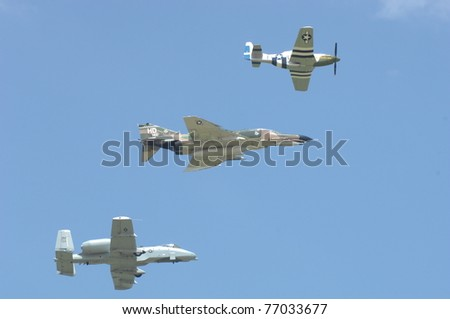 BOSSIER CITY, LA - MAY 8: A WWII P-51, USAF F-4 & an A-10 perform a Heritage formation flypast during an air demonstration for the Barksdale AFB airshow on May 8, 2011 in Bossier City, LA - stock photo