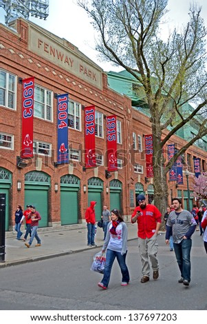 BOSTON - APR 20: Fenway Park on April 20, 2013 in Boston, USA. Fenway Park is the oldest professional sports venue in the United States celebrating its 101th anniversary since its foundation. - stock photo