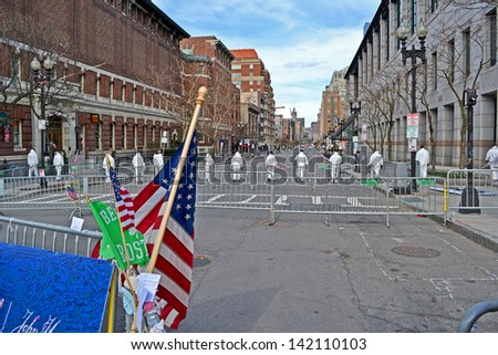 BOSTON - APR 20: People in white hazardous-materials uniform on Boylston Street in Boston, USA on April 20,2013. 3 people killed and over 100s injured during Boston Marathon bombing on April 15, 2013. - stock photo