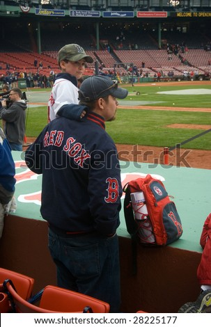 BOSTON - APRIL 7: A man boosts his son up to see players practicing before the game at the Boston Red Sox Opening Day at historical Fenway Park April 7, 2009 in Boston, Massachusetts. - stock photo