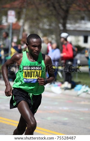 BOSTON - APRIL 18 : Geoffrey Mutai races up Heartbreak Hill during the Boston Marathon April 18, 2011 in Boston. Geoffrey Mutai (Kenya) finished first with a time of 2:03:02. - stock photo