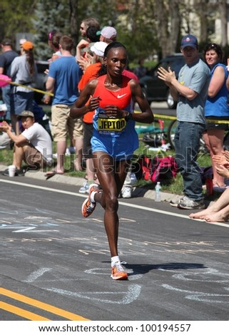 BOSTON - APRIL 16 : Jeptoo (Kenya) races up Heartbreak Hill during the Boston Marathon on a hot 87 degree day on April 16, 2012 in Boston. Sharon Cherop (Kenya) finished first with a time of 2:30:50. - stock photo