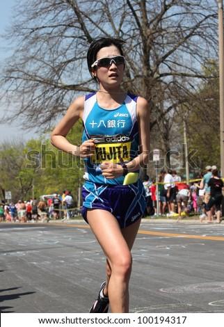BOSTON - APRIL 16: Mayumi Fujita (Japan) races up Heartbreak Hill during the Boston Marathon on April 16, 2012 in Boston. Sharon Cherop (Kenya) finished first with a time of 2:30:50. - stock photo